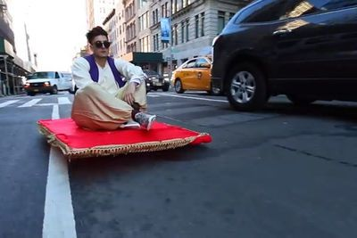 Man Dressed As Aladdin And Rides Magic Carpet Through The City. Watch How People Reacts!