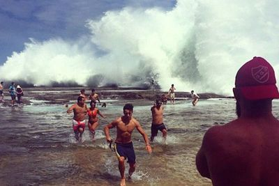 Video: Meanwhile In Australia... Rogue Wave Wipes Out Beachgoers!