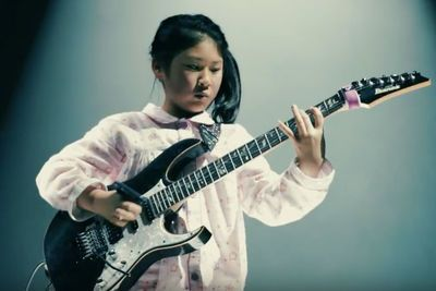 Video: 11 Year Old Japanese Girl Rocks Out Guitar Solo Using A Debit Card!
