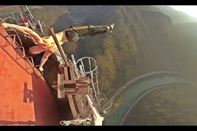 Video: Guy Climbs Highest Chimney In Europe At 360 Meters, Does A Human Flag At The Top!