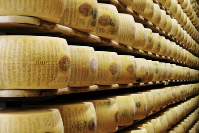 The Reason Why Parmesan Cheese Is So Expensive